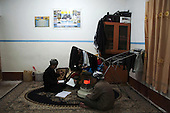 BIARA, IRAQ: Yahia and Mahmud, both 13, study in their shared room in the evening...The Biara Madrassa--a religious school--is located high up in the mountainous Kurdish Hawraman region that makes up the Iran/Iraq border. Before 2003 the region was home to a fundamentalist Islamic group called Ansar al-Islam who used the school as a base. The Unites States military attacked the area and the madrassa numerous times during the 2003 invasion, finally pushing Ansar al-Islam out...Today the madrassa is home to 48 male students from all across Kurdish Iraq. The students leave their families and immerse themselves in their studies and the daily life of Koranic students...Photo by Besaran Tofiq