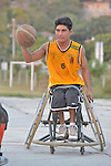 Roel Hernandez dribbles the basketball while pushing his wheelchair forward during practice in Zipolite, a town in Oaxaca, Mexico. Hernandez plays on the Oaxaca Costa wheelchair basketball team.