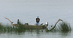 A couple of men in a tin fishing boat on the Delta near Sacramento California.