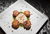 Sea scallops with roasted pine nuts, pesto and a cauliflower purée, Bolt Bistro, 219 Fayetteville Street, Raleigh, Thursday, Nov. 1, 2012.