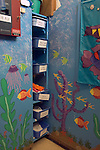 Berkeley CA  Well organized supply area at Spanish-English bilingual preschool,decorated with an underwater theme