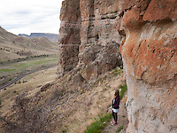 Aubrey McClaran hiking and exploring the Clarno Unit of the John Day Fossil Beds, near Fossil, Oregon