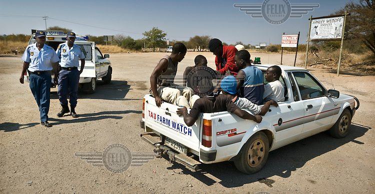 "White farmers arresting Zimbabwean immigrants who have attempted to cross the South African-Zimbabwean border illegally after cutting holes in the border fence. The men, known as ""border jumpers"", have been apprehended by the farm owners patrolling their farmland near the border crossing at Musina near Beitbridge. The arrested migrants will be handed over to the police, who will then extradite them to Zimbabwe. However, many of the border jumpers will again attempt to cross the border within only a few hours of their first arrest."