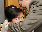 Taiwanese Wedding -- And finally, putting jewelry on the bride.