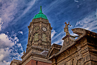 Dublin Castle's clock tower stands off to the side of the entrance gate in Ireland.
