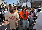 Protestors rally outside a Catholic Mass in Port-au-Prince that marked the one-year anniversary of the January 12, 2010, earthquake that devastated Haiti.  The demonstrators, who burned a priest's car, were upset about the government's management of the quake recovery. Held in the shadows of the ruins of the city's Catholic cathedral, the Mass was one of many special observances held throughout the Caribbean nation...