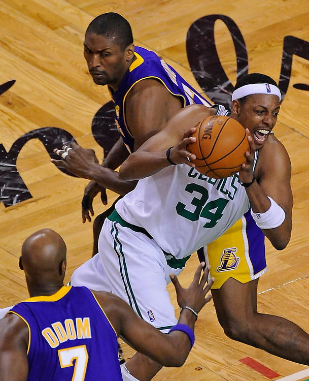 Boston Celtics forward Paul Pierce drives through Los Angeles Lakers forward Lamar Odom, left, and Los Angeles Lakers forward Ron Artest during the fourth quarter of game five of the NBA Finals in Boston on Sunday, June 13, 2010.