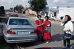 SOWETO, SOUTH AFRICA - MAY 15: Event agency owner Palesa Gcaba (c) chats with her mother and and a neighbor outside the house where she grew up in on May 15, 2010, in Soweto, South Africa. Palesa is part of the new young generation of black South African's who has obtained a better education and opportunities than their parents. She organizes big events for government departments and private business. Because of being  black and a women, she can tender for government contracts much easier than being a white person. She lives in a posh Johannesburg suburb and drives a late model BMW. Soweto is the largest township in South Africa, located about 10 kilometers southwest of downtown Johannesburg. The population is estimated to be around 2-3 million. (Photo by Per-Anders Pettersson)