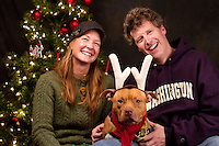 Chica and her foster parents Jane Taylor and Mitch Price are photographed at a Muttmixer holiday party thrown by City Dog magazine in Seattle, WA on December 09, 2010. (photo by Karen Ducey)