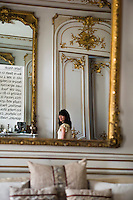 Capucine Gougenheim-Geagea is reflected in one of the gilt-framed mirrors in her living room