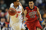 Florida's Mike Rosario (3) vs. Ole Miss' Marshall Henderson (22) in the SEC championship game at Bridgestone Arena in Nashville, Tenn. on Sunday, March 17, 2013.