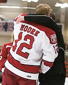Colin Moore (Harvard - 12), Keith Moore - The Harvard University Crimson defeated the visiting Clarkson University Golden Knights 3-2 on Harvard's senior night on Saturday, February 25, 2012, at Bright Hockey Center in Cambridge, Massachusetts.