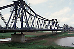 Heavily damaged during the Vietnamese war by American planes and repaired, the Paul Doumer Bridge's outer spans are now used only for foot and bicycle traffic in Hanoi, North Vietnam.  (Jim Bryant Photo)....