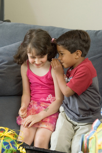 Berkeley CA  children ages four and five sharing a secret