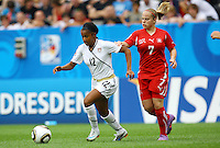USA's Zakiya Bywaters (L) and Lara Keller of Switzerland during the FIFA U20 Women's World Cup at the Rudolf Harbig Stadium in Dresden, Germany on July 17th, 2010.