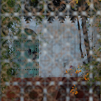 Medina, Tangier, Morocco pictured on December 27, 2009. An atmospheric view through a screened window of a courtyard garden in the Old Town lit by dappled winter sunshine. Tangier, the 'White City', gateway to North Africa, a port on the Straits of Gibraltar where the Meditaerranean meets the Atlantic is an ancient city where many cultures, Phoenicians, Berbers, Portuguese and Spaniards have all left their mark. With its medina, palace and position overlooking two seas the city is now being developed as a tourist attraction and modern port. Picture by Manuel Cohen