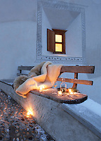 A rustic wooden bench at the approach to the chalet is lit with tealights providing a romantic spot for an evening drink