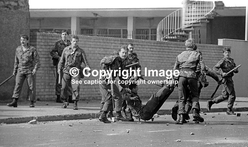 The Silver Jubilee visit of Queen Elizabeth II to N Ireland on 10th &amp; 11th August 1977 sparked serious rioting in Belfast as those opposed to the visit tried to reach the city centre. Soldiers drag an injured colleague to safety.  1977081000744k<br /> <br /> Copyright Image from Victor Patterson, 54 Dorchester Park, Belfast, UK, BT9 6RJ<br /> <br /> Tel: +44 28 9066 1296<br /> Mob: +44 7802 353836<br /> Voicemail +44 20 8816 7153<br /> Email: victorpatterson@me.com<br /> Email: victorpatterson@gmail.com<br /> <br /> IMPORTANT: My Terms and Conditions of Business are at www.victorpatterson.com