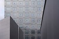 PARIS, FRANCE -JUNE 29 : A detail of the Institut du Monde Arabe, on June 29, 2008, in the 5th arrondissement of Paris, France. Built in 1987-88 to designs by Jean Nouvel, a French architect born in 1945, the building is one of the Grands Projets encouraged by President Mitterand in the 1980s, whose purpose is to foster knowledge of Arab world culture. Of frame and glass curtain wall construction, a main feature is the South facade, seen here through the main entrance. The decorative pierced diaphragms react to sunlight and control the light levels in the building captured here on a summer evening.  (Photo by Manuel Cohen)