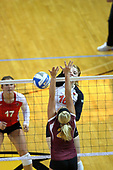 13 September 2011: Shannon McGlaughlin hits towards the Loyola Ramblers defense during an NCAA volleyball match between the Ramblers of Loyola and the Illinois State Redbirds at Redbird Arena in Normal Illinois.