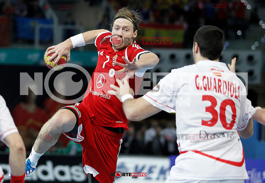 Hungary's Gabor Csaszar (l) and Spain's Gedeon Guardiola during 23rd Men's Handball World Championship preliminary round match Hungary v Spain.January 17,2013. (ALTERPHOTOS/Acero)