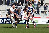 21.02.2015.  Sale, England.  Aviva Premiership Rugby. Sale Sharks versus Saracens. Saracens flanker Jackson Wray is tackled by Sale Sharks lock Nathan Hines.