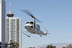 03-01-13 : Helicopters arrive from North Las Vegas Airport land at Las Vegas Convention center Green lot in Preparation for next weeks Helicopter convention  © Larry Burton Photography