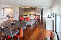 A minimalist kitchen with sleek lines, Lutron battery-operated window shades and Control4 home automation system.
