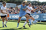02 December 2012: UNC's Kelly McFarlane (center) is defended by Penn State's Mallory Peterson (25) and Christine Nairn (10). The University of North Carolina Tar Heels played the Penn State University Nittany Lions at Torero Stadium in San Diego, California in the 2012 NCAA Division I Women's Soccer College Cup championship game. UNC won the game 4-1.