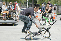 Markis Andrada from Skate Park Association Street Team performs stunts on a BMX during Santa Monica Public Library's bicycles and cycling iCycle festival on Saturday, May 22, 2010
