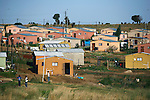 SOWETO, SOUTH AFRICA DECEMBER 17: An overview of newly built government subsidized small houses on December 17, 2006 in Soweto, Johannesburg, South Africa. Many people live in these types of houses. Soweto is South Africa?s largest township and it was founded about one hundred years to make housing available for black people south west of downtown Johannesburg. The estimated population is between 2-3 million. Many key events during the Apartheid struggle unfolded here, and the most known is the student uprisings in June 1976, where thousands of students took to the streets to protest after being forced to study the Afrikaans language at school. Soweto today is a mix of old housing and newly constructed townhouses. A new hungry black middle-class is growing steadily. Many residents work in Johannesburg but the last years many shopping malls have been built, and people are starting to spend their money in Soweto. .(Photo by Per-Anders Pettersson/Getty Images)..