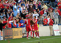 Chicago forward Collins John (15) is mobbed by teammates Calen Carr (3), Mike Banner (18), and Krzystof Krol (23) after John scored to put the Fire up 1-0.  The LA Galaxy tied the Chicago Fire 1-1 at Toyota Park in Bridgeview, IL on September 4, 2010