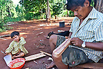 Angel Morinigo, an Mbya Guarani craftsman and musician from Andresito village near San Ignacio, Misiones, Argentina, hand-building a Guarani 3-string violin (rabe).
