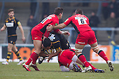 Billy Vunipola of London Wasps RFC runs into the solid defence of Justin Melck and Nils Mordt of Saracens RFC - London Wasps RFC vs Saracens RFC - Aviva Premiership Rugby at Adams Park, Wycombe Wanderers FC - 12/02/12 - MANDATORY CREDIT: Ray Lawrence/TGSPHOTO - Self billing applies where appropriate - 0845 094 6026 - contact@tgsphoto.co.uk - NO UNPAID USE.