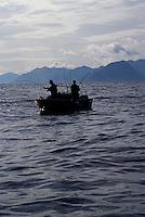 Two fishermen with a double hookup of Chinook salmon, Haida Gwai, Britsh Columbia, Canada
