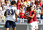 Calcio, Serie A: Roma-Bologna. Roma, stadio Olimpico, 16 settembre 2012..AS Roma forward Erik Lamela, of Argentina, right, is hugged by teammate Alessandro Florenzi after scoring as Bologna midfielder Panagiotis Kone, of Greece, left, reacts during the Italian Serie A football match between AS Roma and Bologna, at Rome, Olympic stadium, 16 September 2012. .UPDATE IMAGES PRESS/Isabella Bonotto