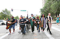 12 AUGUST, 2015, SAINT LOUIS, MO: On Monday, fifty seven people were arrested as part of the #UnitedWeFight march and peaceful civil disobedience at the Thomas F. Eagleton U.S. Courthouse - remembering the the year-long resistance sparked in #Ferguson by the murder of #MikeBrown<br /> <br /> (photo &copy;Heather Wilson)<br /> <br /> Together, hundreds of community leaders, activists, organizers and clergy from the St. Louis area and nationwide, demanded US Attorney for the Eastern District of Missouri, Richard Callahan, do his job and take immediate action on the findings of the scathing Department of Justice reports.<br /> <br /> &ldquo;The Department of Justice reports merely confirmed what the local community knows all too well, but the almost complete lack of action on the multitude of well documented state abuses is just one more betrayal of the people of St Louis and the black and brown community nationwide,&rdquo; said the Reverend Osagyefo Sekou, Bayard Rustin Fellow with the Fellowship of Reconciliation (FOR). <br /> <br /> When clergy and activists breached the barricades and sat in front of the building, they were slowly arrested as St Louis Police arrived in the dozens.