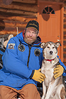 Portrait of musher Dave Dalton and his dog.