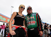 Apr. 15, 2012; Concord, NC, USA: NHRA funny car driver John Force (right) talks with daughter Courtney Force during eliminations for the Four Wide Nationals at zMax Dragway. Mandatory Credit: Mark J. Rebilas-