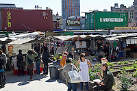 The Dekalb Market in downtown Brooklyn in New York is seen on the seasons opening day, Saturday, April 7, 2012.  The market, which uses decorated and modified shipping containers as kiosks for its vendors, is located in the high density area of downtown Brooklyn and includes vendors selling food, clothing and accessories, all from local sellers. The market is the product of Urban Space, which has over 20 container projects in London and produces temporary Christmas holiday markets in parks in New York.  (© Frances M. Roberts)