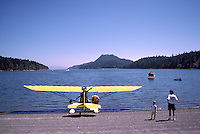 An Ultralight Float Plane moored on the Shore of Browning Harbour, on North Pender Island, in the Southern Gulf Islands, British Columbia, Canada