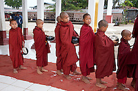 Myanmar, Burma.  Young Buddhist Monks Lining up to go to a Ceremony, Alodaw Pauk Pagoda, Nampan Village, Inle Lake, Shan State.