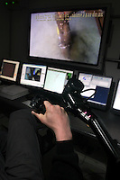 Operating the hydraulic arm is done watching a big TV screen on deck..The Norwegian designed and built ROV has transferred the brush and fingertip sensitivity of an archaeologist of flesh and blood, to a hydraulic arm of equal tenderness. It digs, sucks sludge and picks up fragile objects without causing any damage. ©Fredrik Naumann/Felix Features