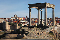 Los Cuatro Postes (The Four Posts), 16th century; City Walls, 11th-14th century, with Cathedral, in the distance (looking West), Avila, Castile and Leon, Spain. This simple shrine, a cross covered by a canopy supported by 4 Doric columns, marks the place where St Theresa's uncle prevented her and her brother from seeking martyrdom in battle with the Moors. Picture by Manuel Cohen