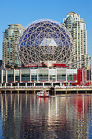 Vancouver, BC, British Columbia, Canada - Telus World of Science (aka Science World) at False Creek - Renovation at Science World completed in 2012. Aquabus Neighbourhood Ferry in foreground.