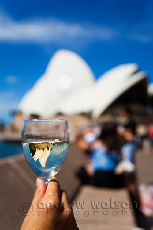 Enjoying a glass of wine at the Opera Bar on Sydney harbour.  Sydney, New South Wales, AUSTRALIA