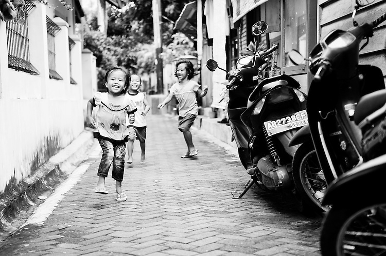Kids Running Along a Side Street in Yogyakarta, Java, Indonesia - DSC