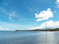 One of the few exquisite beaches on Yap Island. Most of the coastline is covered by foliage right down to the waterline.