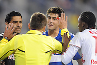 FC Dallas goalkeeper Dario Sala (44) and George John (14) argue with referee Alex Prus after Macoumba Kandji (10) of the New York Red Bulls was fouled in the penalty box. The New York Red Bulls defeated FC Dallas 2-1 during a Major League Soccer (MLS) match at Red Bull Arena in Harrison, NJ, on April 17, 2010.