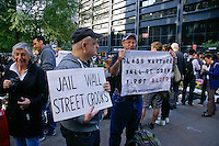 "Protestors hold ""Jail Wall Street Crooks"" and ""Class Warfare.."" signs at the Occupy Wall Street Protest in New York City October 6, 2011."